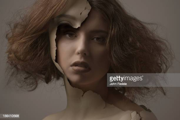 caucasian woman with broken plastic skin - caucasian appearance stock pictures, royalty-free photos & images