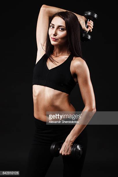 Caucasian woman with dumbbells