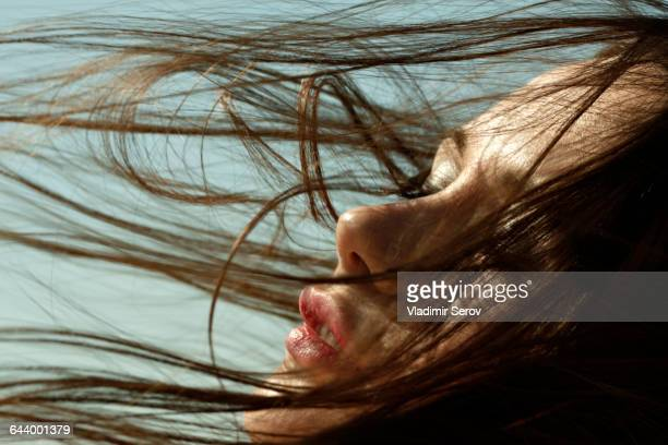 caucasian woman with hair blowing in wind - 官能 ストックフォトと画像