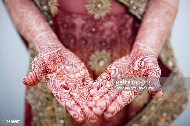 Caucasian woman with Indian henna tattoos on her hands