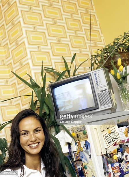 caucasian woman ( 30-35 years) with long dark hair in kitchen laughing - 30 34 years fotografías e imágenes de stock