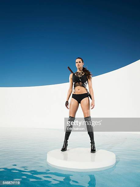 Caucasian woman with sword standing on ice floe