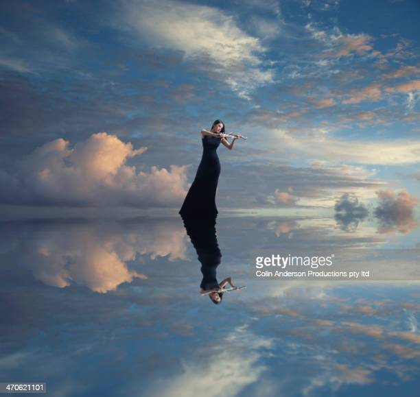 caucasian woman with violin reflected in still lake - blue dress stock pictures, royalty-free photos & images