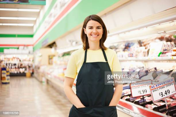 Caucasian woman working in grocery store
