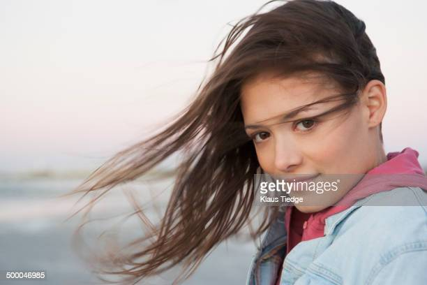Caucasian woman's hair blowing in wind