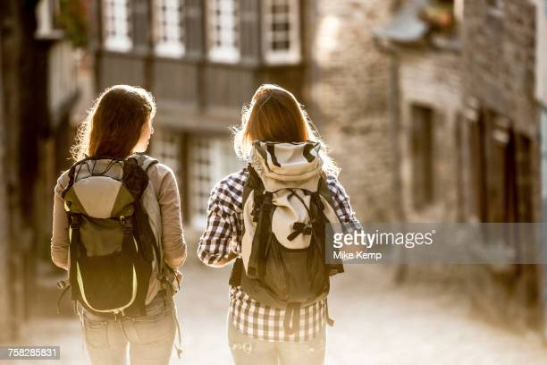 Caucasian women backpacking in city