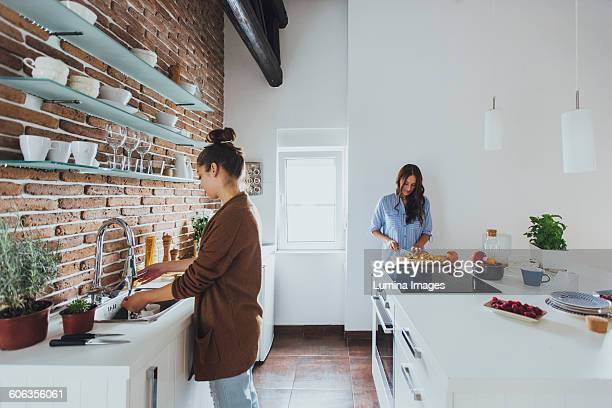 Caucasian women cooking in kitchen