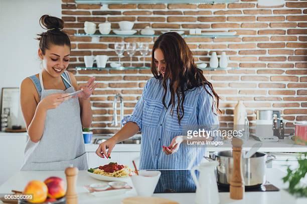 Caucasian women cooking pasta in kitchen