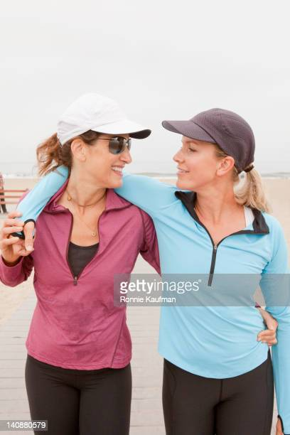 Caucasian women hugging after exercise