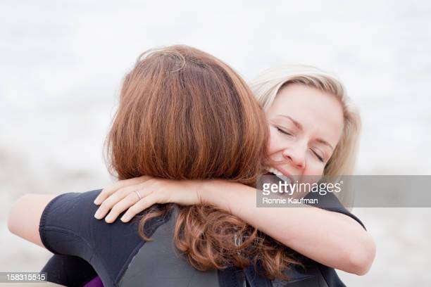 Caucasian women hugging