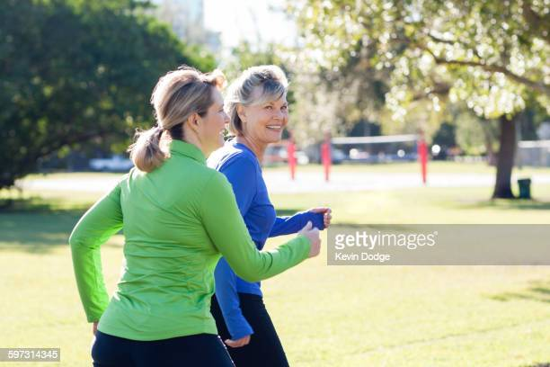 Caucasian women jogging in park