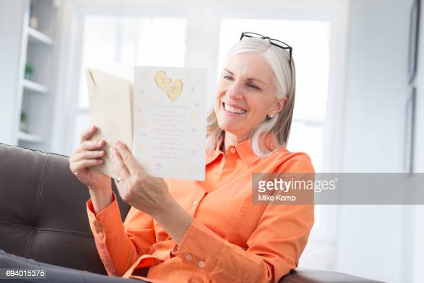 Caucasian women reading greeting card