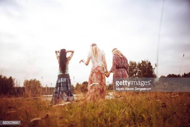 Caucasian women standing in field