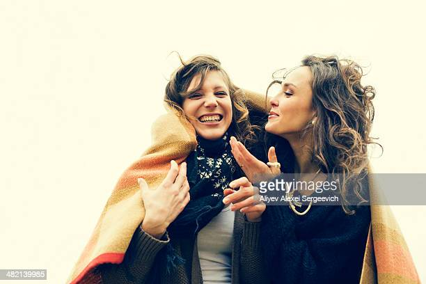 caucasian women wrapped in a blanket - sister stock pictures, royalty-free photos & images
