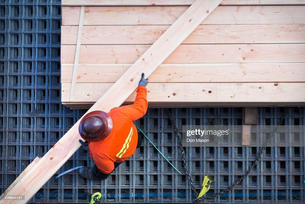 Caucasian worker at construction site : Stock Photo