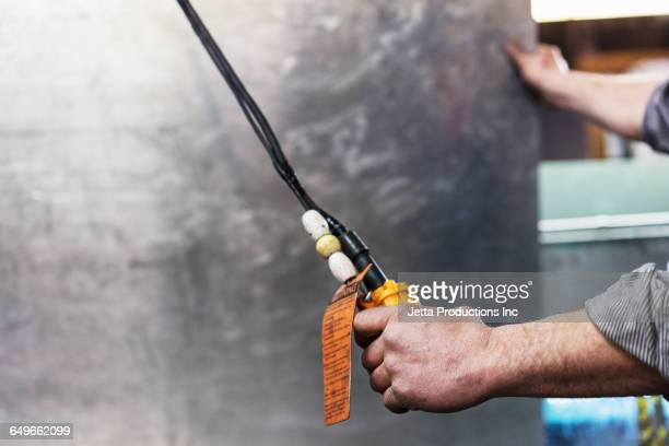 Caucasian worker holding switch in workshop