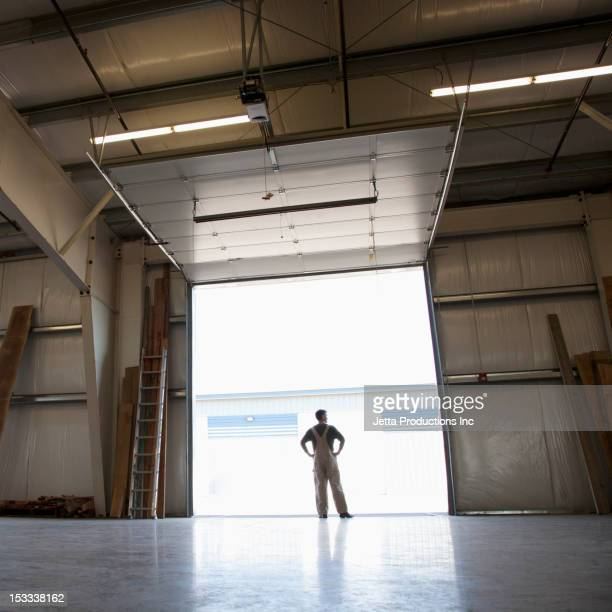 Caucasian worker in empty warehouse