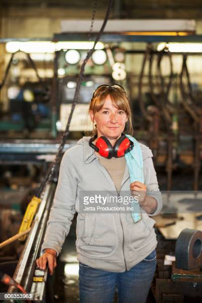 Caucasian worker smiling in factory