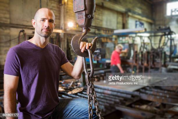 Caucasian worker standing in factory