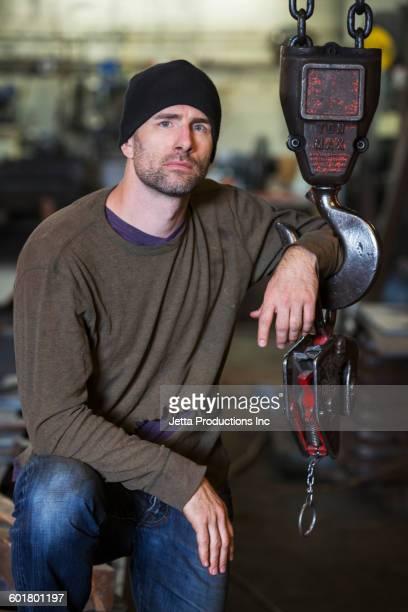 Caucasian worker standing in factory