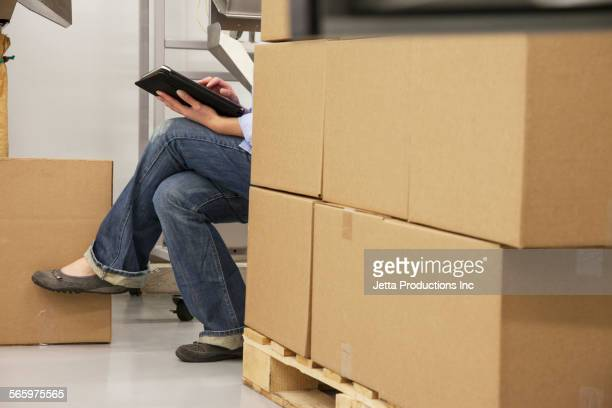 caucasian worker using digital tablet in warehouse - obscured face stock pictures, royalty-free photos & images