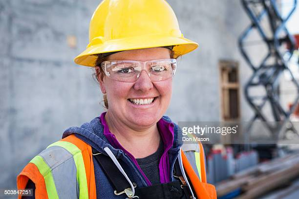 Caucasian worker wearing safety goggles on site
