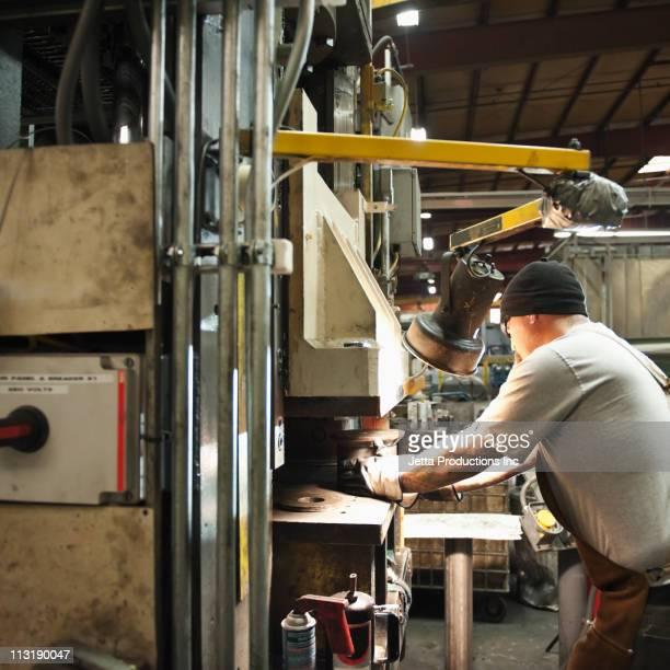 Caucasian worker working in factory