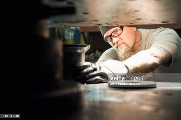 Caucasian worker working in factory