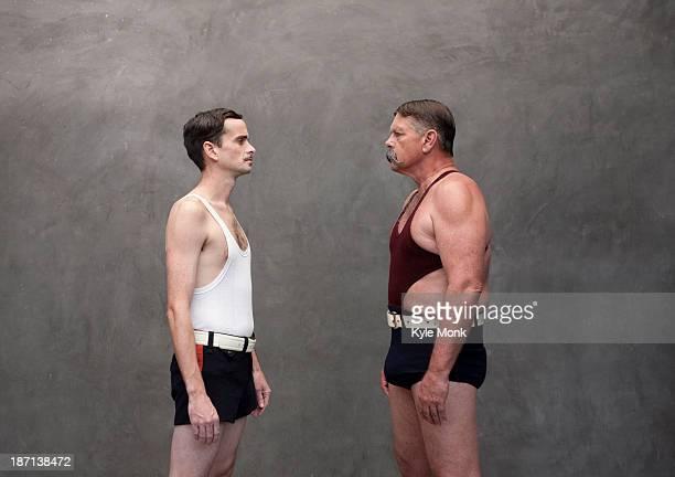 caucasian wrestlers examining each other - rivalidad fotografías e imágenes de stock