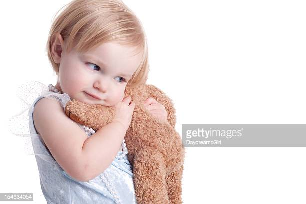 Caucasian young child cuddling a soft toy