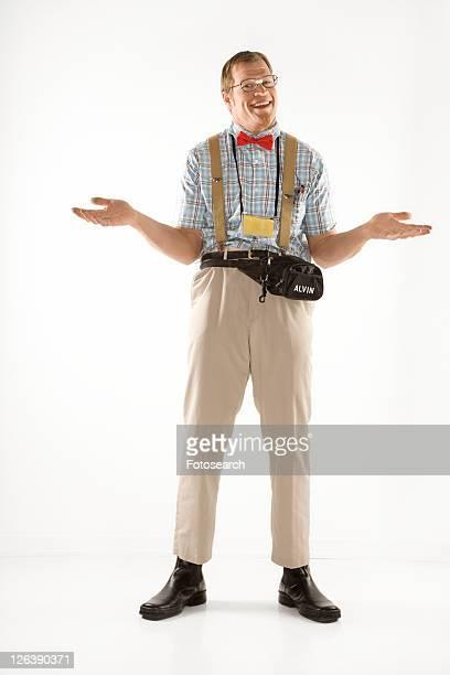 Caucasian young man dressed like nerd shrugging his shoulders.