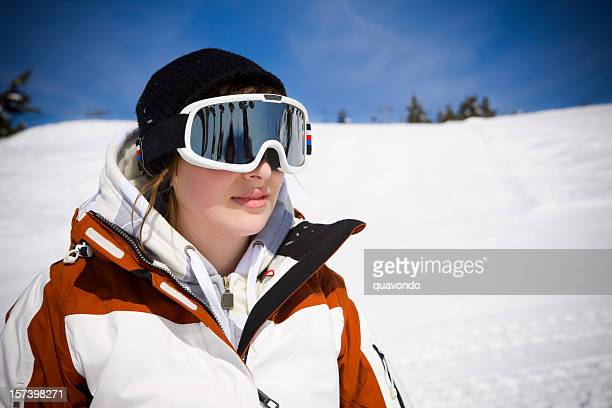 Caucasian Young Woman Snowboarder Portrait on Sunny Snowy Mountain