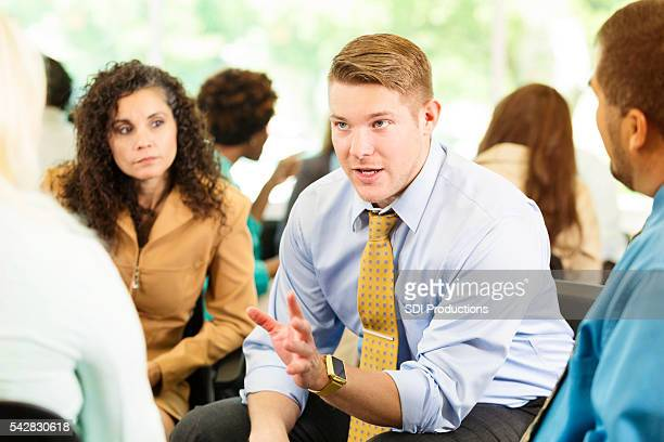 caucasion man deep in discussion - assertiveness stock pictures, royalty-free photos & images