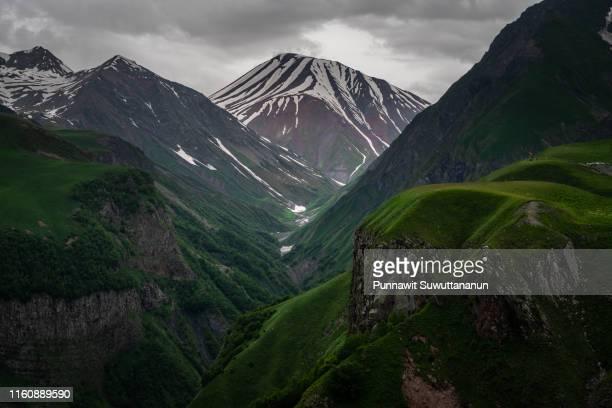 caucasus mountain in cloudy day, georgia - clima alpino foto e immagini stock
