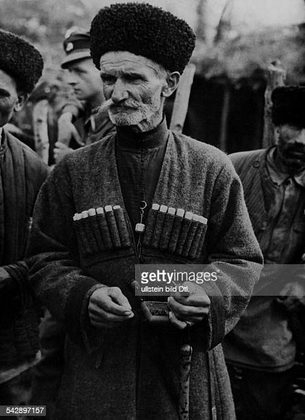 Caucasus Region population views A Kabardinian man in traditional clothing with typical Tscherkeska and Papacha Background a german soldier october...