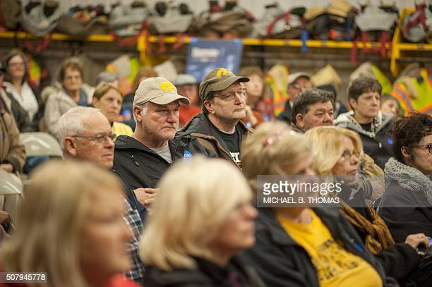 Caucus attendees look on during a Democratic Party Caucus at Jackson Township Fire Station on February 1 2016 in Keokuk Iowa Ted Cruz felled longtime...