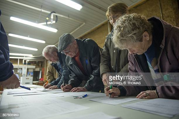 Caucus attendees sign in as they arrive at a Democratic Party Caucus at Jackson Township Fire Station on February 1 2016 in Keokuk Iowa After months...