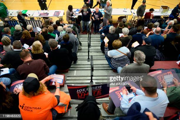 Caucus goers are handed out their first choice cards during caucusing at Abraham Lincoln High School in Des Moines Iowa on February 3 2020