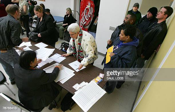 Caucus goers check in at precinct 56 held at the Central Senior Citizen Center a Democratic caucus site in Des Moines Iowa 03 January 2008 AFP...