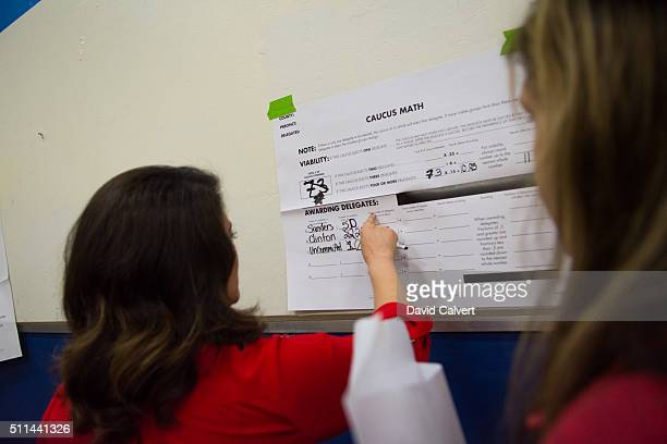 Caucus precinct chair and Nevada Assemblywoman Teresa BenitezThompson tallies supporters at Swope Middle School February 20 2016 in Reno Nevada...