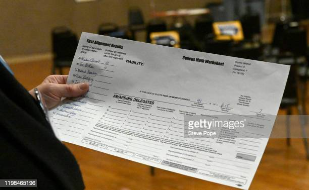 Caucus volunteer works on paper work on February 3 2020 in Carpenter Iowa Iowa is the first contest in the 2020 presidential nominating process with...