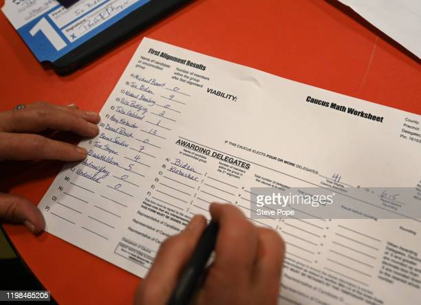A caucus volunteer works on paperwork on February 3 2020 in Carpenter Iowa Iowa is the first contest in the 2020 presidential nominating process with...