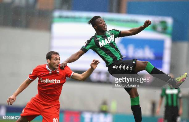 Caud Adjapong of Sassuolo competes for the ball with Sebastian Cristoforo of Fiorentina during the Serie A match between US Sassuolo and ACF...