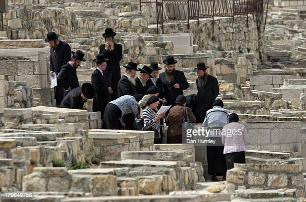 CONTENT] I caught a touching moment while walking though the Mount of Olives Many Jews have wanted to be buried on the Mount of Olives since...