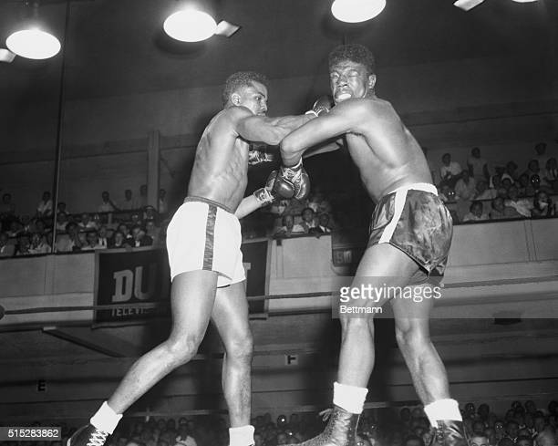 """Caught in a Storm. New York: Tommy """"Hurricane"""" Jackson, Far Rockaway heavyweight, moves in with a rollicking right to the jaw of Jimmy Slade of New..."""
