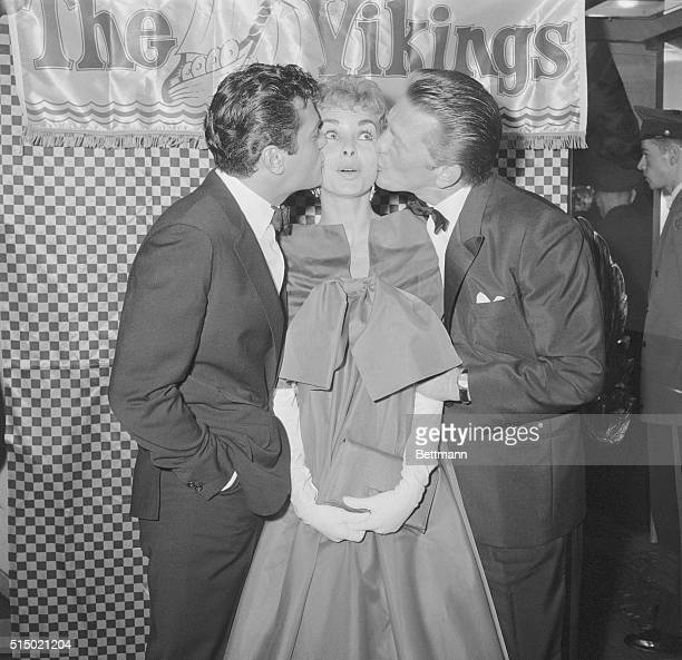 Caught in a twoway smackup Janet Leigh get plenty of lip from husband Tony Curtis and Kirk Douglas The three stars smooched while making personal...