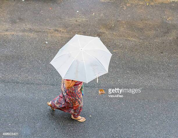 caught in rain - monsoon stock pictures, royalty-free photos & images