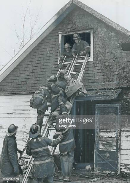 Caught in the holocaust which engulfed the Downsview home of David Lumsden early today; the blanket-wrapped body of one of his six dead children is...