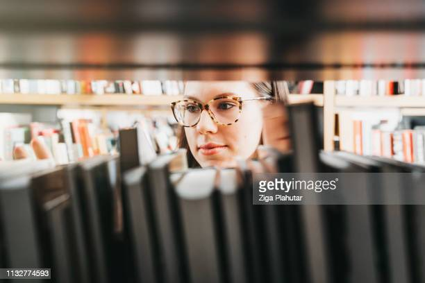 caught looking at the books - literature stock pictures, royalty-free photos & images