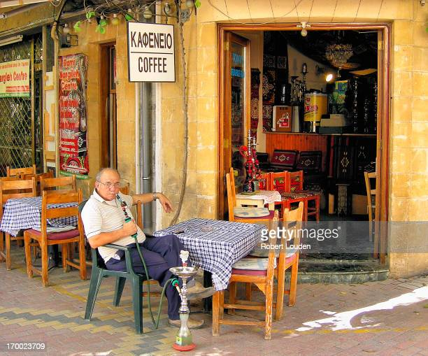 CONTENT] I caught this shot whilst walking around Nicosia in Cyprus The owner of the coffee shop was taking a smoke break <a...